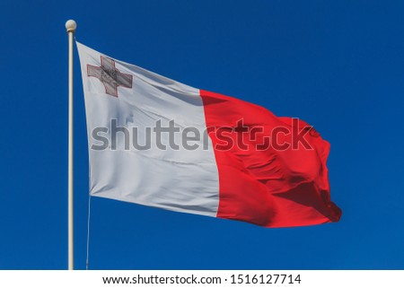 Malta national flag is waving in deep blue sky background #1516127714