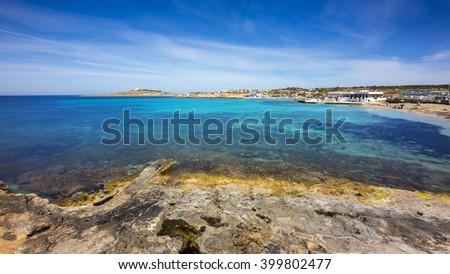 Malta - Palm beach on a sunny day with blue sky #399802477