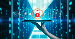 Malware and cyber crime by an anonymous hacker concept.Businessman holding antivirus icon on blurred server background using protection network security computer to block a cyber attack and Malware.