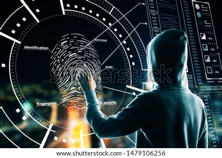 Malware and security concept with back view hacker pushing on fingerprint on digital screen with cyberspace icons.