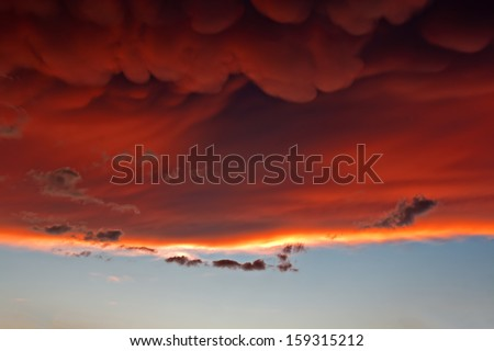 Mammatus clouds forming at sunset ahead of severe thunderstorm