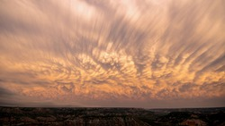 Mammatus clouds with vibrant color over Palo Duro Canyon in Texas after a storm.