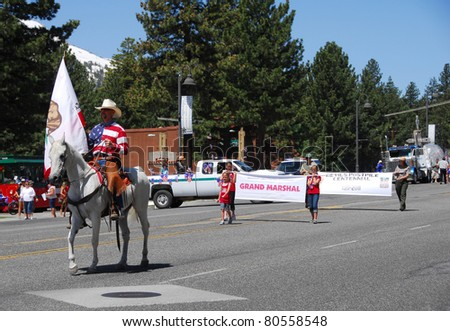 MAMMOTH LAKES, CA/USA - JULY 4 : Independence Day Parade featuring Devils Postpile 100th Birthday Centennial celebration float at mammoth lakes california on July 4 2011. This is an annual event.