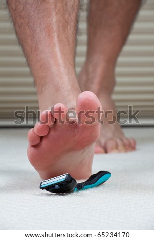 Man about to step on a razor