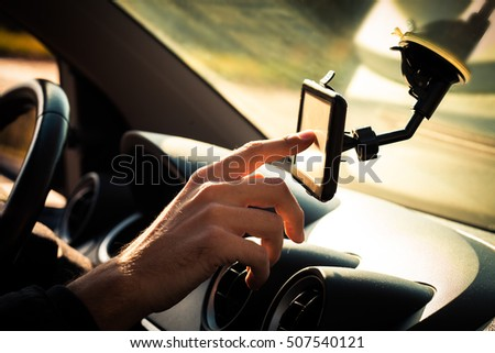 man  adjusting  gps in car closeup #507540121
