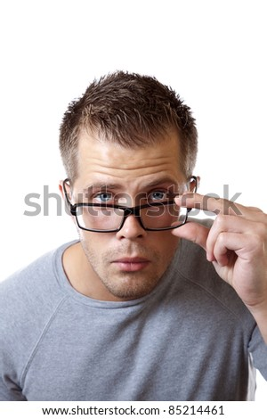 Man adjusting his glasses to get a better view