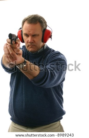 Man aiming a pistol at shooting range