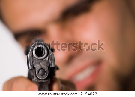 Man aiming at spectator with gun