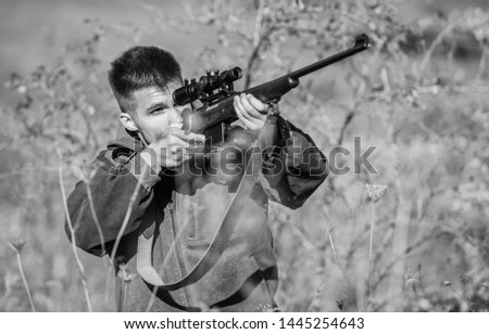 Man aiming target nature background. Aiming skills. Hunter hold rifle. Hunting permit. Bearded hunter spend leisure hunting. Hunting equipment for professionals. Hunting is brutal masculine hobby. #1445254643