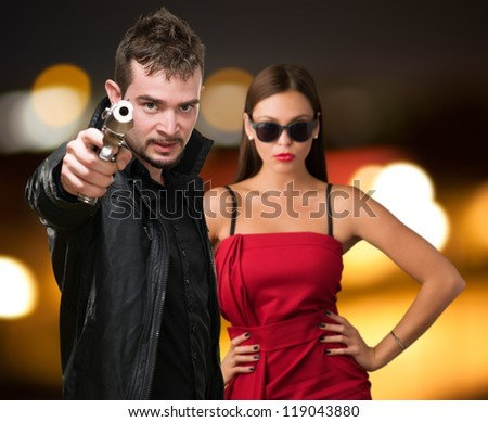 Man Aiming Through Gun, Outdoor