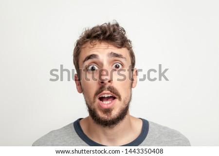Man amazed face, close up portrait.