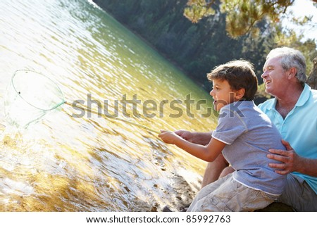 Man and boy fishing together