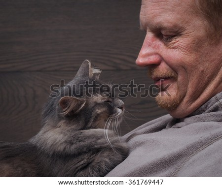 Man and cat sleeping together. Man and cat happy. Rest together