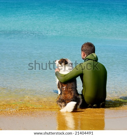 man and dog sitting in the water
