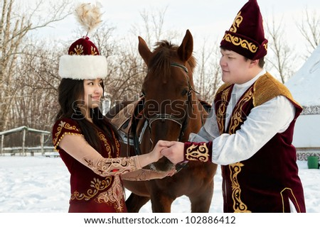 man and girl with horse