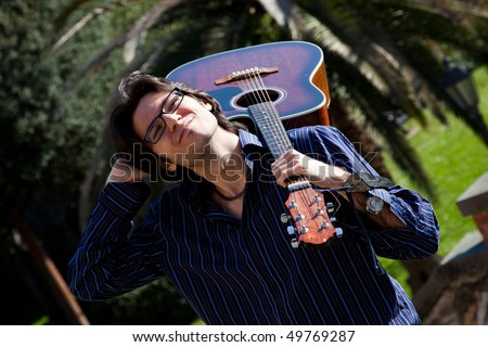 man and his acoustic guitar