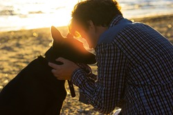 man and his dog on the beach. best friends