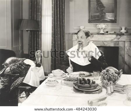 man and his pet turkey sitting...