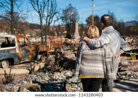 Man and his wife owners, checking burned and ruined of their house and yard after fire, consequences of fire disaster accident. Ruins after fire disaster. #1143280403