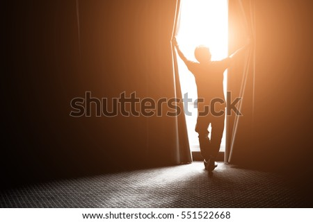 Shutterstock man and hope concept . man opening window curtains