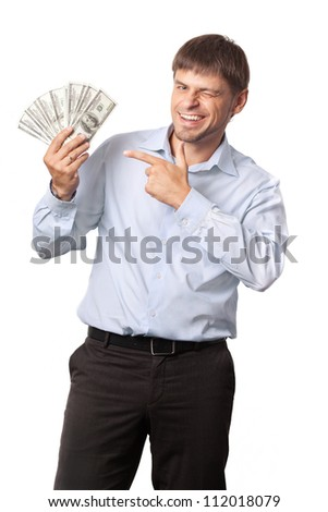 Man and money.Businessman.Man winks and indicate to money White background.