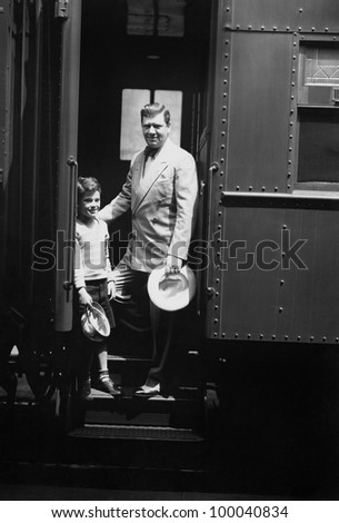 Man and son on train