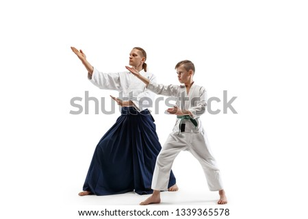 1fe80ff4d4121 Man and teen boy fighting at Aikido training in martial arts school. Healthy  lifestyle and