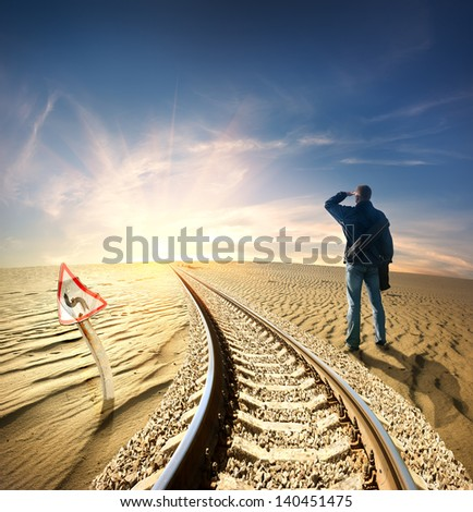 Man and the railway in the desert