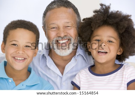 Man and two young children smiling