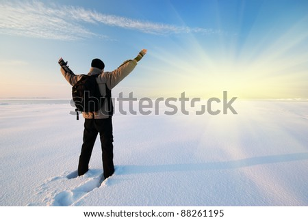 Man and winter plain. Conceptual scene. - stock photo
