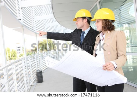 Man and woman architects on a building construction site