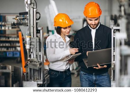 Man and woman at a factory #1080612293