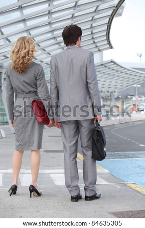 Man and woman at the airport