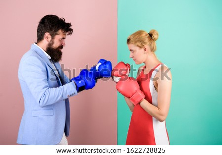 Man and woman boxing fight. Family life. Complicated relationships. Couple romantic relationships. Boxers fighting gloves. Difficult relationships. Couple in love competing boxing. Conflict concept. Stock photo ©