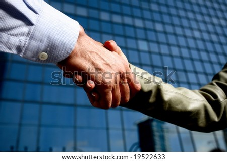 man and woman business team shaking hands
