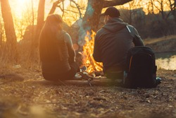 man and woman by the fire in the park