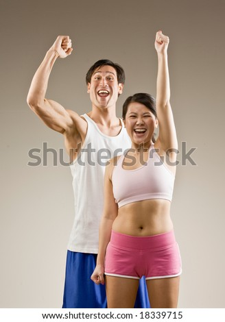 Man and woman cheering and celebrating their success