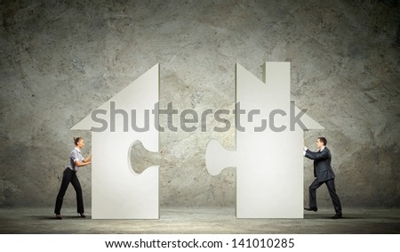 Man and woman connecting house puzzle symbol