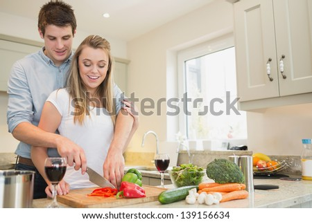 Man and woman cooking together in kitchen