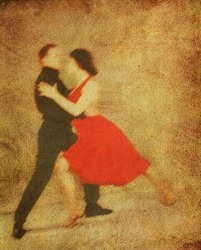 man and woman dancing tango.  background