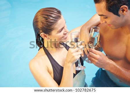 Man And Woman Drinking Together Glass Of Champagne In Swimming Pool Stock Photo 102782675