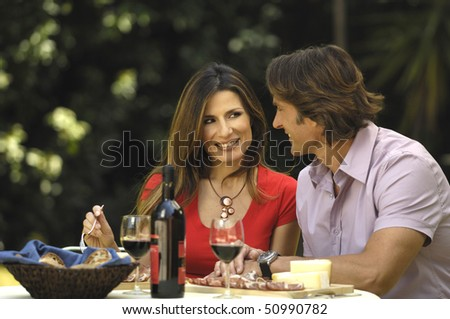 Man and woman eating in the garden