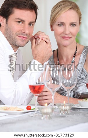 man and woman enjoying a good meal
