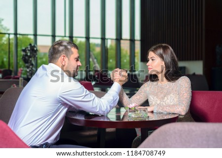 man and woman fight on their hands.  concept rivalry and power #1184708749