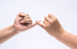 Man and woman finger holding together,concept friendship sign