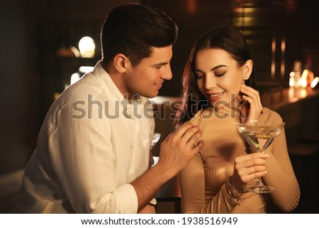 Man and woman flirting with each other in bar Stock photo ©