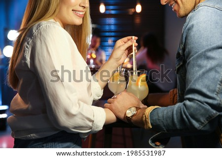 Man and woman flirting with each other in bar, closeup Stock photo ©