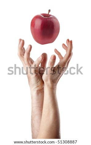 Man and woman hand trying to catch an apple. 