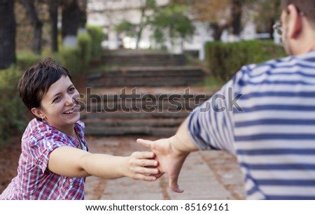 Man and woman hands reaching for each other