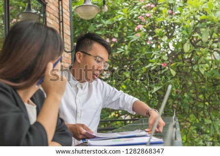 Man and woman having team discussion at outdoor space #1282868347